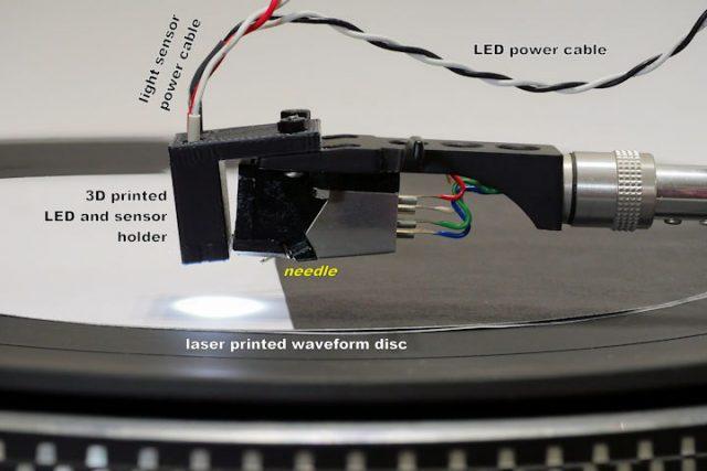 Light-sensor-atop-record-player-needle